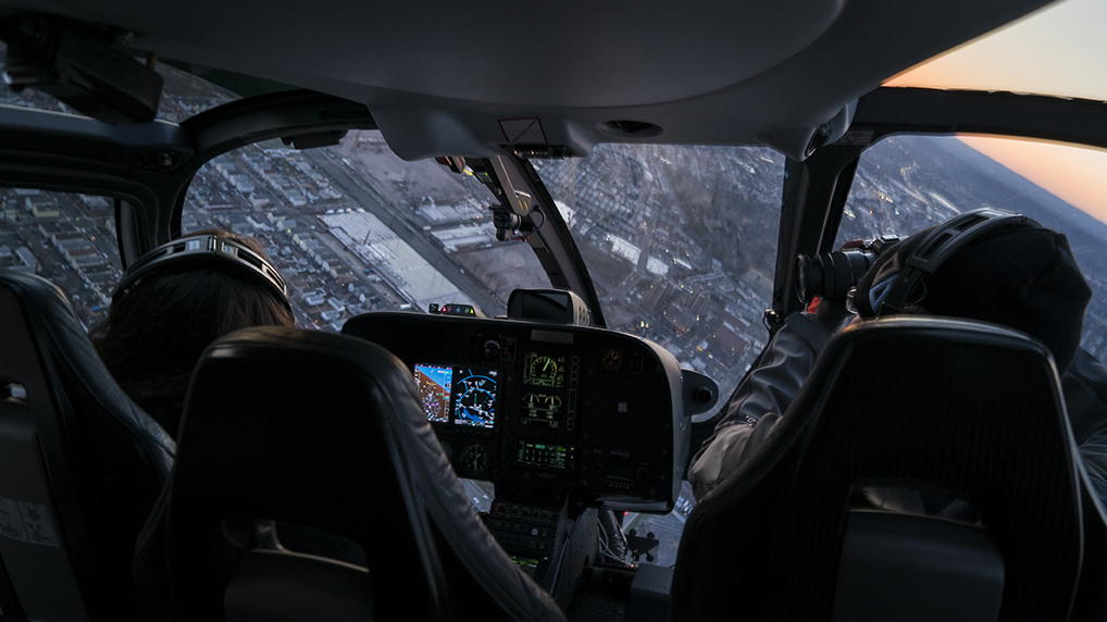 Person taking pictures from the inside of a helicopter