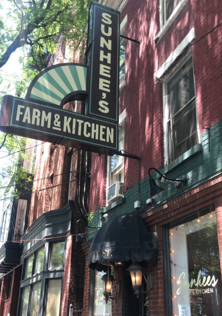 Exterior of Sunshee's Farm & Kitchen red brick building restaurant