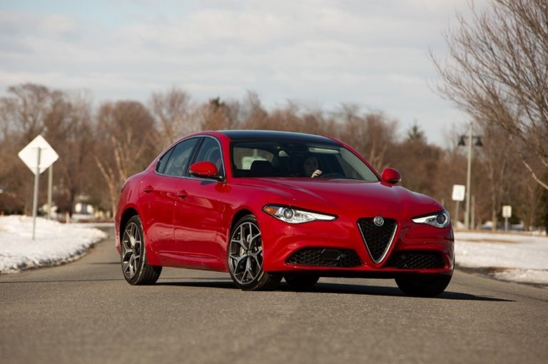 red 2019 Alfa Romeo Giulia Ti sportscar parked diagonally across a paved road
