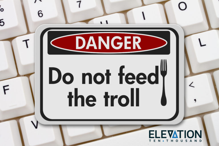 'Do not feed the troll' sign for internet trolls on a white computer keyword