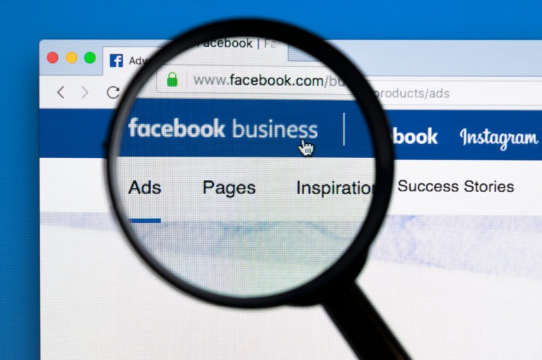 facebook business manager under black magnifying glass