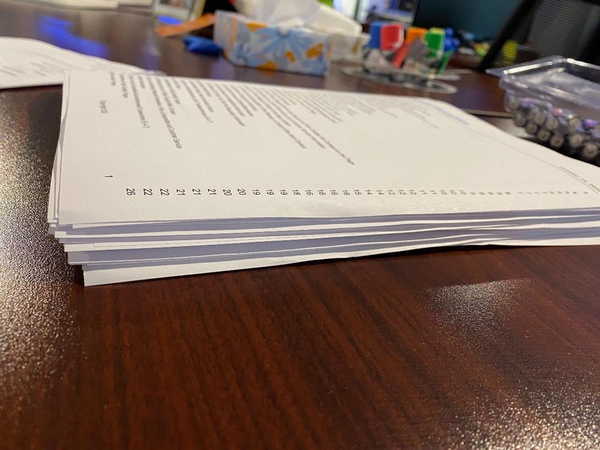 a printout of the full guidelines for the Google search quality raters on an office desk